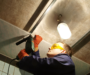 Crowley Construction can install ceiling tiles, industrial lighting, and more